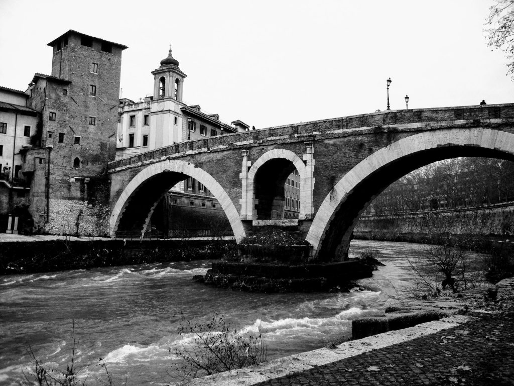 Tiber Island or Isola Tiberina - historic bridges, hospital and basilica