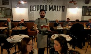 Doppio Malto Rome is a brew restaurant near the Trevi fountain serving craft beers, burgers, grilled meats and great desserts in a post-industrial space.
